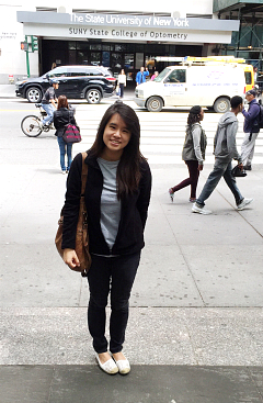 Esther Lin standing outside SUNY School of Optometry in MYC