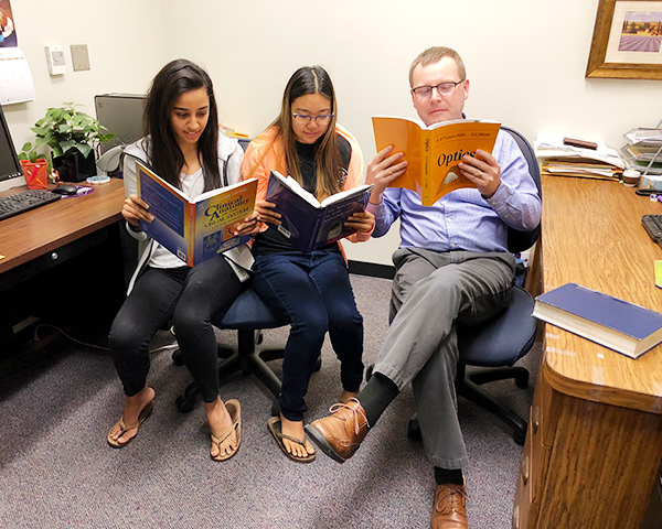SCCO students reading with professor