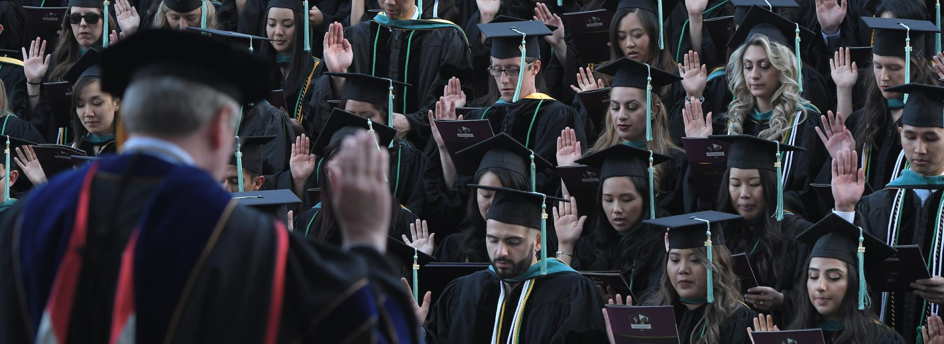 SCCO Graduates take the oath during their commencement ceremony