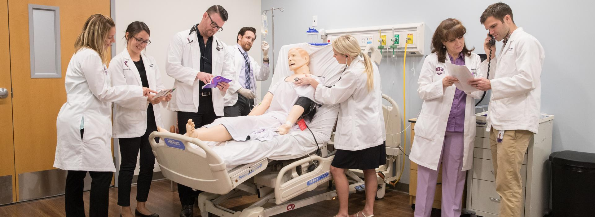 PA students work in the hospital simulation suite